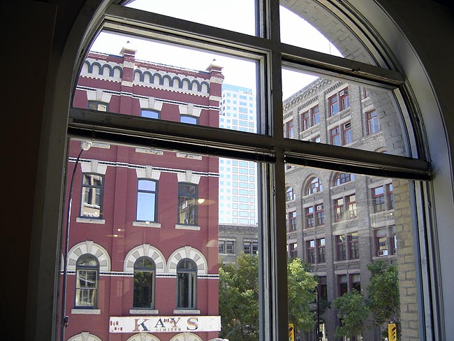 View of Exchange District through arched window